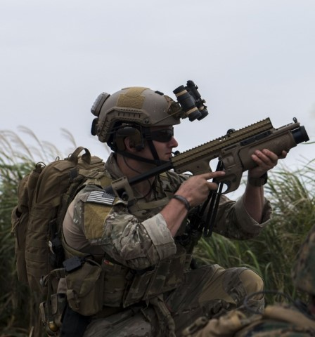 A U.S. Air Force combat control Airman from the 320th Special Tactics Squadron fires a 40 mm grenade launcher during a training exercise March 10, 2017, at the Irisuna Jima Training Range, Okinawa, Japan. The Airman joined a joint training exercise with U.S. Marines from the III Marine Expeditionary Force to pursue advanced JTAC qualifications. Smoke grenades are used as a visual marker for friendly aircraft. (U.S. Air Force photo by Senior Airman John Linzmeier)
