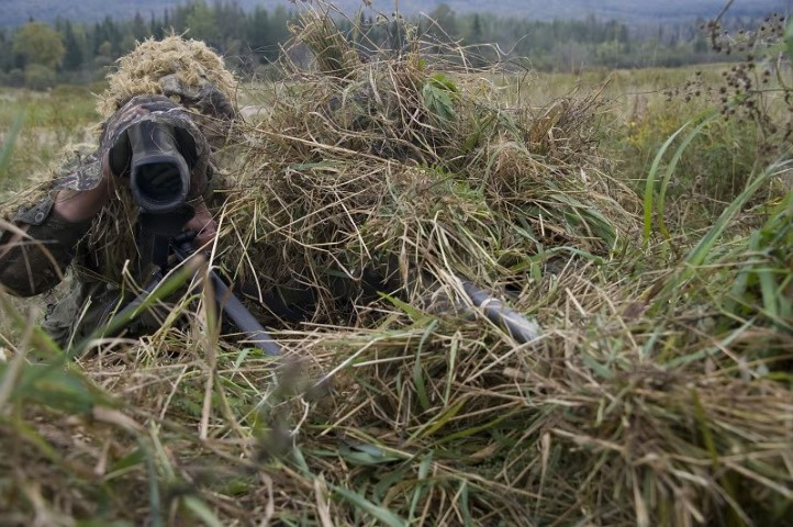 ENGLISH IS2011-5023-06 21 Sept 2011 Canadian Forces Base Valcartier, Quebec  A Canadian Sniper and Spotter undercover of their ghillie suits locate and fire at targets during the live fire phase of Exercise Tireur Accompli.   Exercise Tireur Accompli is the final exercise on the basic sniper course. It aims at enabling candidates to apply the variety of skills and techniques that were taught during the course, such as the setting of observation posts, stalking, materiel destruction and engaging targets. The exercise was held at CFB Valcartier from 19-23 September 2011.  Photo by Corporal Jax Kennedy, Canadian Forces Combat Camera © 2011 DND-MDN Canada
